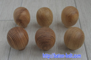 Wooden ball under the palm